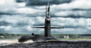 Submarine surfacing close to shore.